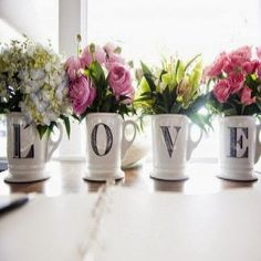 From ciao! newport beach: use multiple initial mugs as flower vases and spell out a word
