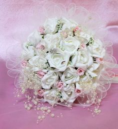 white roses bridal bouquet with pearl accent