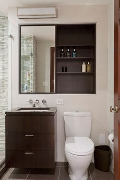 Simple small bathroom storage solutions for modern bathroom design with bathroom mirror and floating vanity also wall mount faucet and neutral bathroom Toilet Storage, Small Bathroom Storage, Bathroom Design Small, Bathroom Layout, Simple Bathroom, Bathroom Interior, Bathroom Ideas, Bath Design, Small Storage