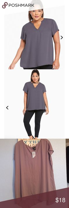 Hi-Lo Georgette Top from Torrid Day-dressing just got a whole lot simpler with this top. Grey georgette lends a lightweight and breezy feel, while the slightly shirred back and split neck are sophisticated elements. The hi-lo hem keeps the look (and you) relaxed.           ❌ The model in the pic is wearing a slightly different cut which can be seen at the neck. Those 2 pics were posted to visual purposes only ❌ torrid Tops Blouses