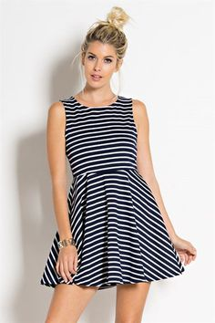 This adorable navy and white striped a-line dress is super flattering and comfortable! Made of stretchy material with a zipper back. This dress is perfect to add a gameday bow to! Vestidos Boutique, Boutique Dresses, Stretchy Material, Navy And White, Ideias Fashion, Dresses For Work, My Style, Shopping, Collection