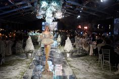 In 2011, the Paris event included a fashion show with models sporting looks inspired by classic fairy-tale dresses. Flanked by the stage and bar, a 246-foot-long reflective runway ran the entire length of the tent and served as the site for the show.