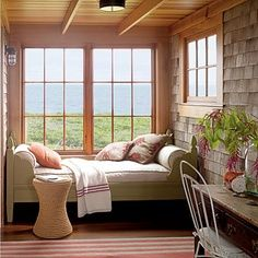 This little nook is designed specifically for relaxing. A twin bed fits perfectly into the space, giving the illusion of a built-in window seat. Accent pillows and a throw blanket make the space extra cozy. (originally from Coastal Living) Interior Exterior, Interior Design, Interior Walls, Kitchen Interior, Interior Modern, Bathroom Interior, New England Style Homes, Summer Bedroom, Window Bed