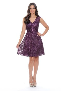 Be fun and flirty in this dark purple dress with sequence rose details! Style #182711