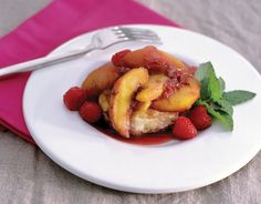 For Summer Garden Party Serve Fresh Fruits:     Serve fresh fruits that are in season, such as this delicious grilled peach and raspberry cobbler. Mint from the garden is used as a garnish. For the recipe, go to countryliving.com/cobbler.