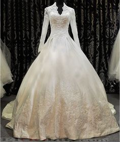 princess cut wedding dress with long sleeves - very fairytaleish. I like the poofy skirt, but the collar cut just didn't grab me