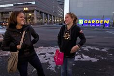 The news inspired fans Jen Parisi (left) and Laurel Ryan to visit Causeway Street after they shopped on Newbury Street.