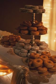 BNJ: kind of love the idea of a powdered sugar/cinnamon donut hole tree at the cake table--on a vintage cake tray.