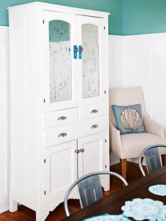 A fresh coat of white paint and new hardware brought the hutch up-to-date! http://www.bhg.com/decorating/makeovers/furniture/fabulous-furniture-makeovers/?socsrc=bhgpin022115addareflection&page=8