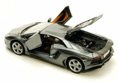 """Lamborghini Aventador LP700-4 Hard Top Gray 1:24 scale 34210 by Maisto. $15.99. Showcasts - Lamborghini Aventador LP700-4 Hard Top. 1:24 scale diecast collectible model car. This Lamborghini Aventador LP700-4 is a 7.75""""L x 3.25""""Wx 1.75""""H die cast metal car with free wheeling, openable doors & trunk. This Lamborghini Aventador LP-700-4 is manufactured by Maisto...   This item is UNBOXED .... Adult collectible"""
