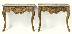 date unspecified A pair of Louis XV carved oak console tables  mid-18th century, probably Liégeois  5,000 — 7,000 GBP 8,287 - 11,601USD LOT SOLD. 7,500 GBP (12,430 USD) (Hammer Price with Buyer's Premium)