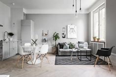 Grey living room with open kitchen