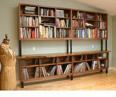 Walnut bookcase - -- walnut cabinets with english elm slab counter on steel bases