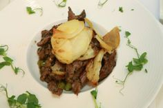 #NorthWales Life Luncheon - Bodnant #WelshFood. #Main; Crochan of Welsh spring #lamb with #leeks and laverbread served with Aberwen cheese glazed #potatoes.