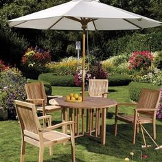 """New 5 Pc Luxurious Grade-A Teak Dining Set - 48"""" Round Table And 4 Stacking Arm Chairs [Model:LB2] by WholesaleTeak. $741.99. This is brand new teak dining set (100% teak) sold at very low price.. Approx. Dimensions: Table: 48"""" Diameter, 30.5"""" H Chair: 25"""" W, 23 1/2"""" D, 36 1/2"""" H. Round table folds in butterfly fashion. Also has a hole for an umbrella.. The chairs are stackable for easy storage.. ADD SUNBRELLA FABRIC CUSHIONS BY SEARCHING """"Wholesaleteak Dining Cus..."""