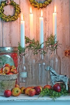 jars with a candle, tied with ribbon & holly branches - super cute!