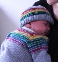 There is a rainbow of hope at the end of every stormAfter the Storm hat & cardigan set, sized for approximately 0-3 months. The cardigan is a top-down raglan with a textured yoke of coloured stripes. It features waist increases to accommodate bulky baby