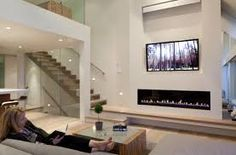Chic Linear Fireplace Provides Sophisticated Fire Element To Your Home: Outstanding Living Room Design With Linear Fireplace And Built In Bench Also Coffee Table And Sofa Linear Fireplace, Fireplace Hearth, Home Fireplace, Modern Fireplace, Living Room With Fireplace, Fireplaces, Mantle, Above Fireplace Ideas, Living Room Designs