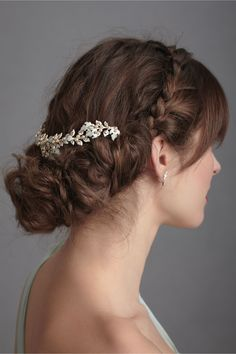 This enameled brass ivy strand by Bhldn wraps around the top of her updo. So chic!