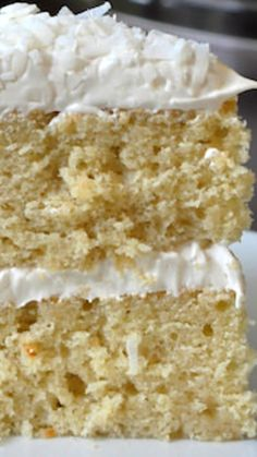 Coconut Velvet Cake ~ A beautifully moist and tender crumbed cake, flavoured with coconut milk and extract, then surrounded in a coconut marshmallow frosting and covered in a generous garnish of dried coconut.