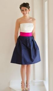 Courtney Two-Tone-  Strapless straight across neckline. Full box pleat party skirt. Back zip. 21 skirt with pockets. Available with ivory silk shantung top and any color bottom. Shown in ivory/navy with Fuschia 3 sash (sold separately).  Available in silk shantung, gazar, faille, and cotton seersucker