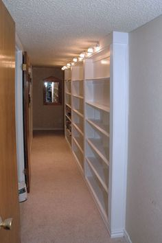 Bookcase counter sunk into wall.  Great idea for narrow storage area in basement stairwell.
