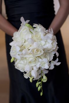 White teardrop bouquet of roses and dendrobium orchids.
