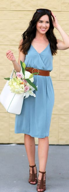 What to wear to a farmer's market and dress to run errands. Under $50 blue wrap dress from Dynamite Clothing, with brown belt and brown heeled sandals. Henri Bendel white tote filled with flowers.