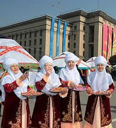 EN: Older ladies congratulating and blessing people with Nauryz (Kazakhstan)