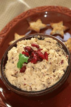 CRANBERRY WALNUT PUMPKIN DIP   -   8 ounces cream cheese   1 cup dried cranberries, plus a tablespoon for garnish   3/4 cup toasted walnut or pecan pieces   1/2 cup pumpkin puree   3/4 teaspoon cinnamon   1/8 teaspoon ground cloves   1/8 teaspoon ground nutmeg