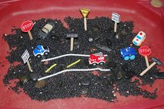 """Busy Street"" Sensory Tub - black beans, rocks, cars, road signs, white and yellow pipecleaners for roads Sensory Tubs, Sensory Rooms, Sensory Boards, Sensory Play, Gross Motor Activities, Sensory Activities, Classroom Activities, Classroom Ideas, Creative Curriculum Preschool"
