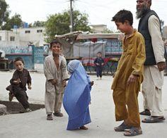 Teeny tiny burqa! (Back Street Jalalabad by Jeremy Rata)