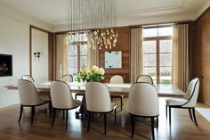 Jose Solis Betancourt and Paul Sherrill added a  dose of glamour in the #dining #room with a sculptural Seed Cloud #chandelier by Ochre, #interior #design #fine #furniture #luxury #home #accessories