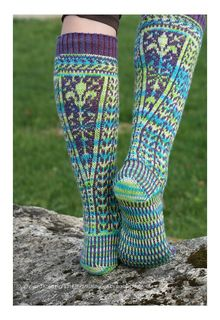 "The design for these knee-highs was inspired by pictures of garments from Eastern Europe at the turn of the 20th century. The shaping pattern was adapted from an embroidered shirt from Russian, and the stripe from a border on a knitted sweater from Latvia. They are named ""Vineyard"" because the design and colours remind me of orderly fields of grapes in the sun."