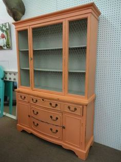 "$275 - This china has Cabinet Chicken wire in the doors - painted salmon and distressed for the shabby ""look"". ***** In Booth D3 at Main Street Antique Mall 7260 E Main St (east of Power RD on MAIN STREET) Mesa Az 85207 **** Open 7 days a week 10:00AM-5:30PM **** Call for more information 480 924 1122 **** We Accept cash, debit, VISA, Mastercard, Discover or American Express"