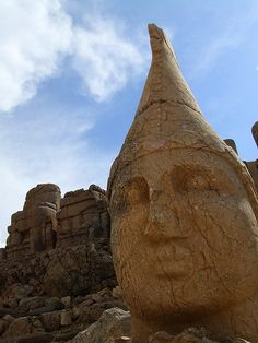Nemrut or Nemrud (Turkish: Nemrut Dağı ; Armenian: Նեմրութ լեռ) is a 2,134 m (7,001 ft) high mountain in southeastern Turkey, notable for the summit where a number of large statues are erected around what is assumed to be a royal tomb from the 1st century BC.