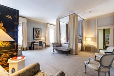 These are San Francisco's most exclusive hotel suites have textured carpets, high ceilings, wood paneled walls, a canopy bed, classic furniture, and ornate screen.