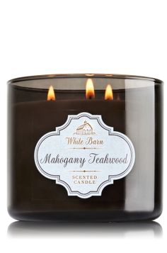"Mahogany Teakwood - 3-Wick Candle - Bath & Body Works - The Perfect 3-Wick Candle! Made using the highest concentration of fragrance oils, an exclusive blend of vegetable wax and wicks that won't burn out, our candles melt consistently & evenly, radiating enough fragrance to fill an entire room. Burns approximately 25 - 45 hours and measures 4"" wide x 3 1/2"" tall."