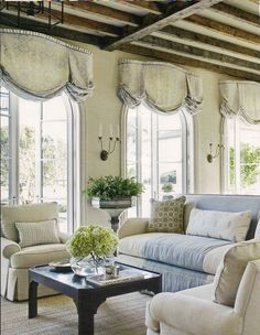 love the shape of these window treatments.  I assume plywood cut in a serpentine shape and attached to wall with large L brackets?