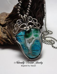 Pendant made with Chrysocolla/Malachite cabochon and wrapped and swirled with Sterling Silver