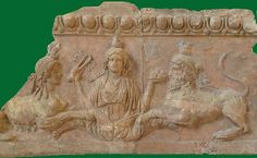 Isis flanked by a male and a female Sphinx | Isis flanked by a male (bearded) and a female Sphinx Rome, Palatine Museum - Isis-relief (terracotta). This is one of several reliefs that formed part of the decoration of the Temple of Palatine Apollo; Isis holds a sistrum and a plate of fruit; she is flanked by a female and a male sphinx. The Egyptian symbolism may have recalled Augustus's victory over Antony and Cleopatra at Actium