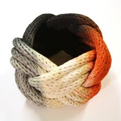 Dipped Rope Bracelet Gray Red now featured on Fab. Looks knitted but certainly could be crocheted.