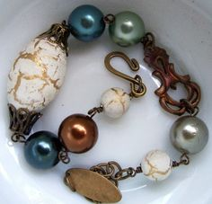 love the color combo and the use of pearls and copper
