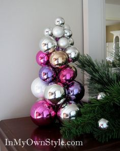 1 2 3... easy tabletop tree made using a knitting needle and ball ornaments- nothing else.