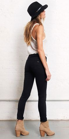 cute look!! Black jeans white tee brown boots hat