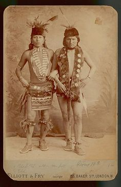 Black Elk and Elk of the Oglala Lakota as grass dancers touring with the Buffalo Bill Wild West Show, London, England, 1887. The men are wearing sheep and sleigh bells; otter fur waist and neck pieces; pheasant feather bustles at the waist; dentalium shell necklaces; and bone hairpipes with colored glass beads. Photograph collected on Pine Ridge Reservation in 1891 by James Mooney. Courtesy National Anthropological Archives, Smithsonian Institution
