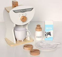 - This White Wooden Toy Coffee machine set will delight any little budding barista. Your child can now make their favorite imaginary beverages during pretend play time. The set includes Wooden carry handle, Wooden Kids Toy Kitchen, Wooden Toy Kitchen, Pretend Play Kitchen, Kitchen Retro, Kitchen Stuff, Cooking Toys, Best Toddler Toys, Baby Gadgets, Toys Online