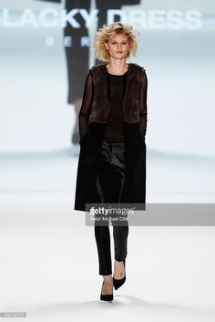 A model walks the runway at the Blacky Dress Berlin show during Mercedes-Benz Fashion Week Autumn/Winter 2014/15 at Brandenburg Gate on January 15, 2014 in Berlin, Germany.