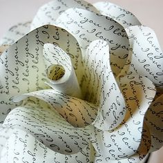 Paper flowers can always add an extra special touch, especially if you're a book-lover getting married. Take some of your favorite books and make flowers from the pages.
