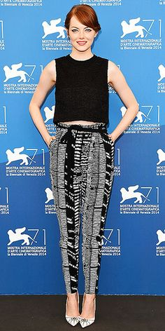 Love Her Outfit | EMMA STONE | Feeling bummed at the prospect of retiring all your fun summer skirts and replacing them with jeans? Consider getting printed bottoms in neutral shades like Emma's Proenza Schouler skinnies. They're much more versatile than pants in bright colors and busy patterns. And with a black top and coordinating heels, they're totally work-appropriate.